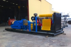 Self contained, skid mounted sludge pump and motor unit