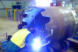 Cutting head for drilling rig